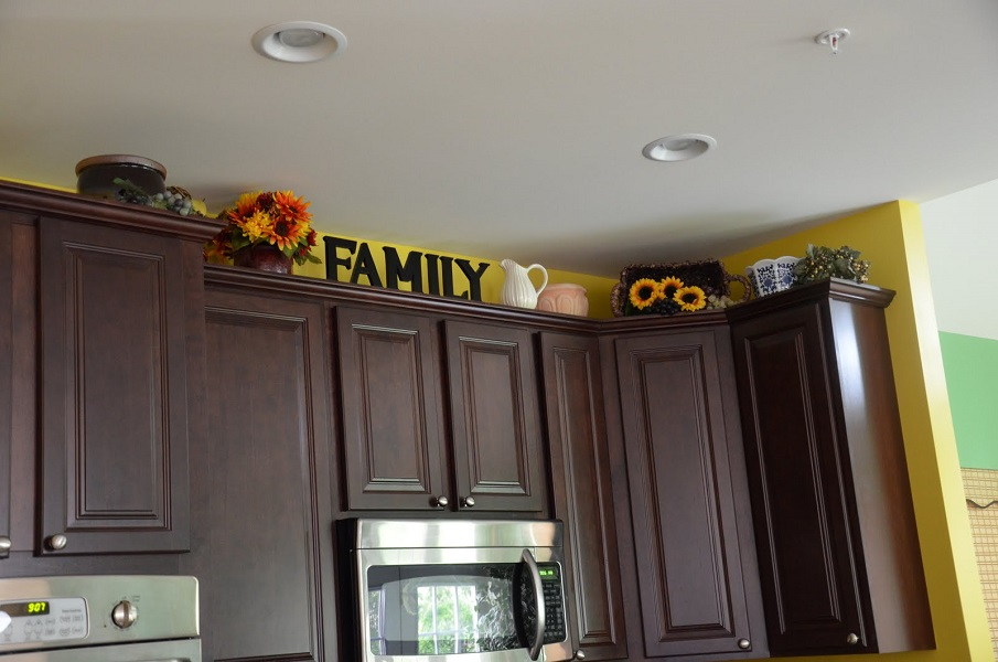 Above kitchen cabinet decor How to decorate top of cabinets
